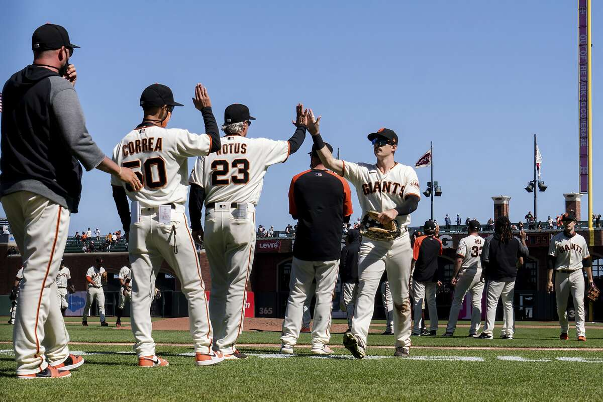 San Francisco Giants' Mike Yastrzemski (fourth from left) celebrates with teammates and staff after defeating the Texas Rangers 4-2 in San Francisco on May 11.