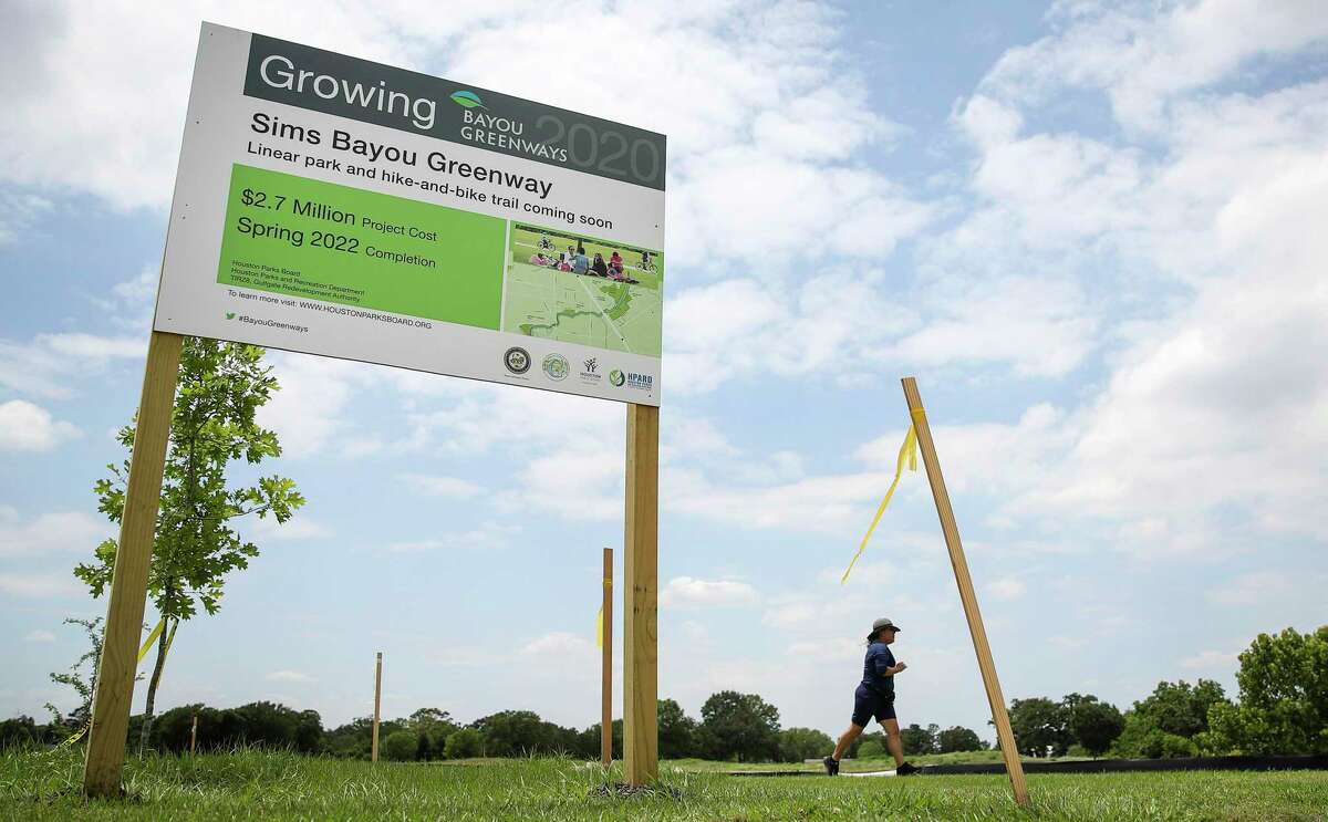 Frine Aparicio jogs May 14, 2021, at Glenbrook Park in Houston. Local officials broke ground Thursday on a 1.1-mile segment of a hike-and-bike trail connecting the park to a trail east of Interstate 45 along the Houston Botanic Garden site.