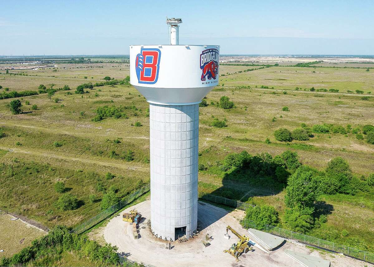 The 170-foot by 70-foot iconic water tower proudly displays the Bridgeland High School logos to show dedication and support for community's first onsite high school.