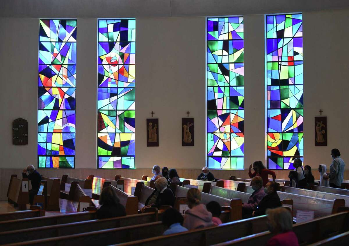 Congregants attend Sunday Mass at St. Paul Roman Catholic Church in Greenwich, Conn. Sunday, May 9, 2021. The church is celebrating its 50 year anniversary of being rebuilt after the previous was destroyed in a fire.