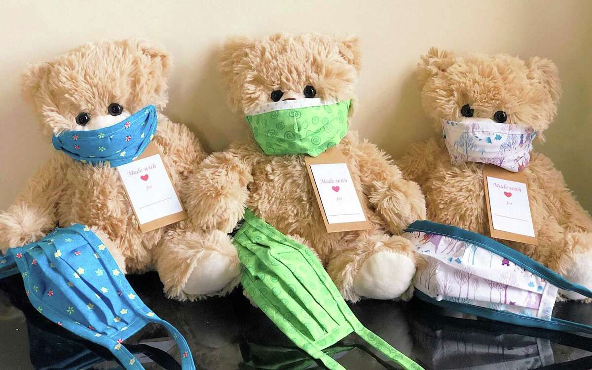 Olivia Carlson's QT Bear company has provided thousands of these bears to children during the pandemic.