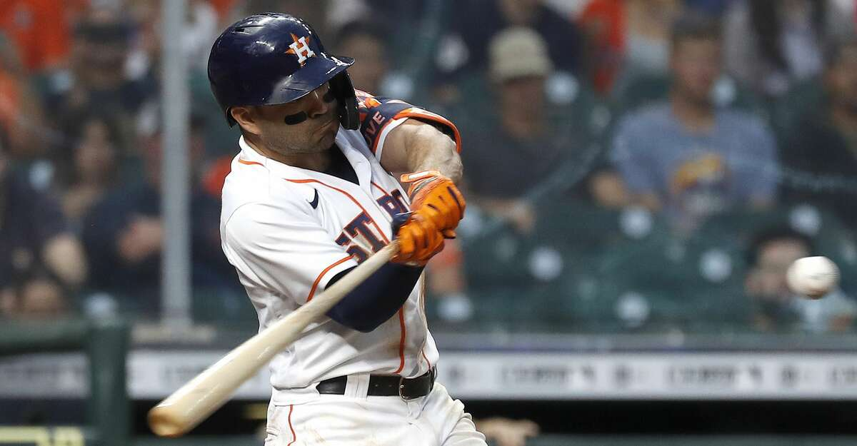 Houston Astros Jose Altuve (27) hits an RBI double during the second inning of an MLB baseball game at Minute Maid Park, Thursday, May 13, 2021, in Houston.