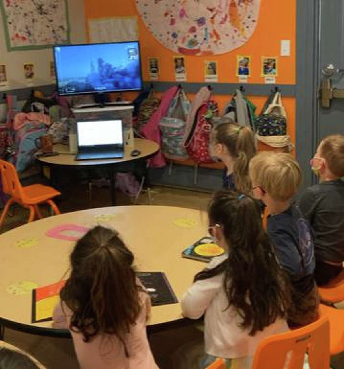 Pre-schoolers at Harbor Light in Fairfield watch a video of a rocket take off as part of a recent talk with Joe Sauvageau, a system manager at NASA Jet Propulsion Laboratory.