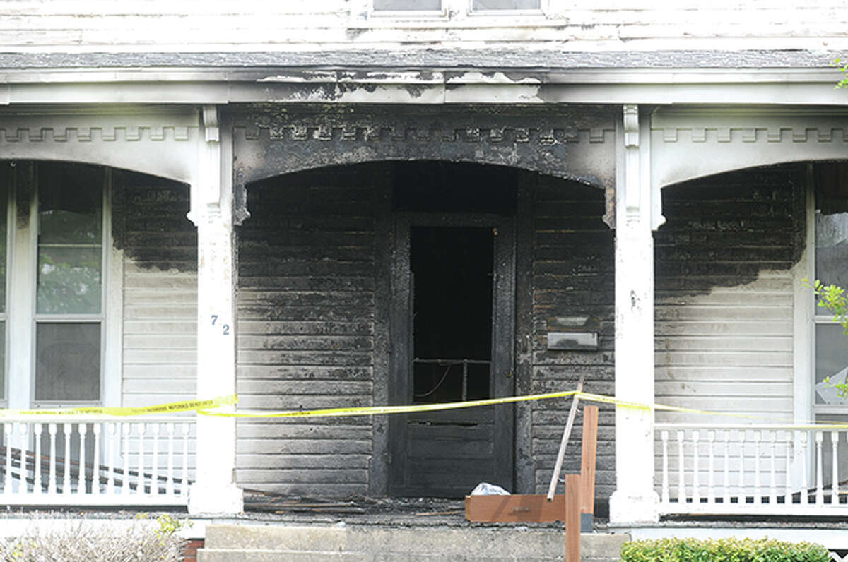 A lighted candle in the first-floor hallway ignited a curtain that was thrown from the second floor causing it to catch fire and spread throughout the home, damaging the integrity of the property Thursday evening.