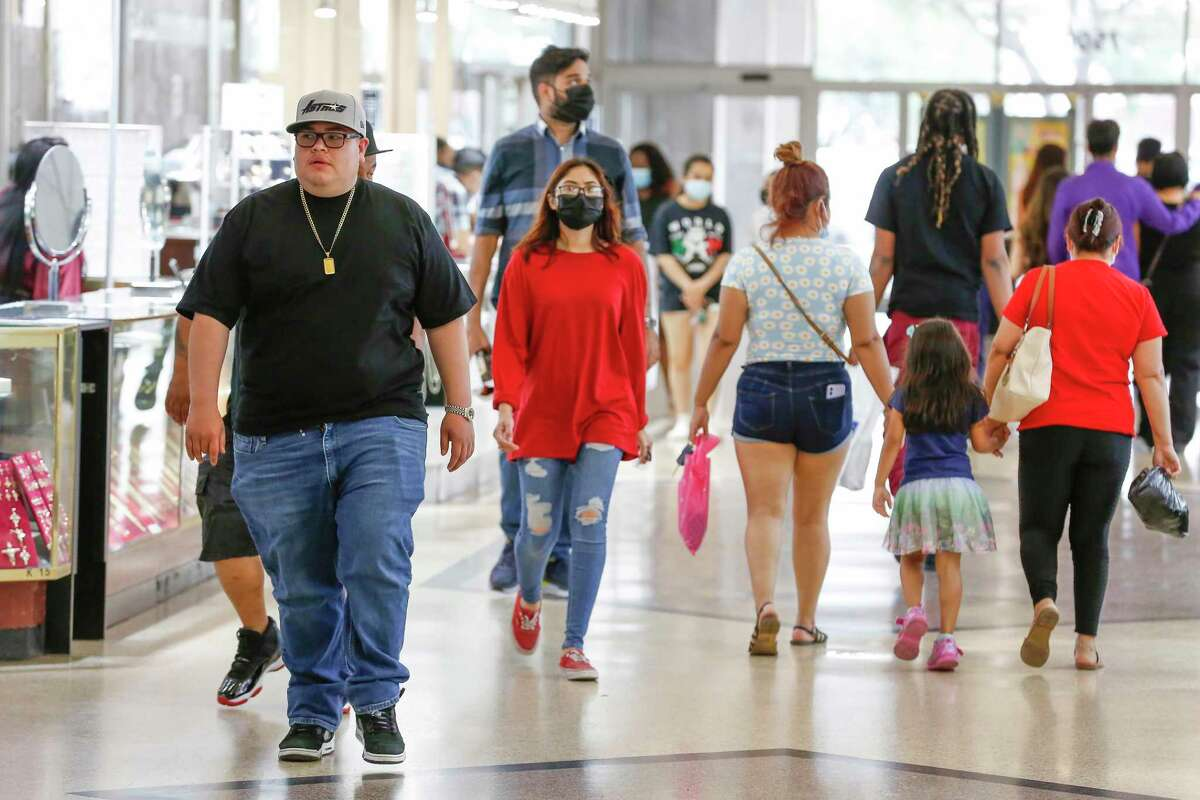 Some shoppers wear masks, but many don't Friday at PlazAmericas Mall, which hasn't required them since March.