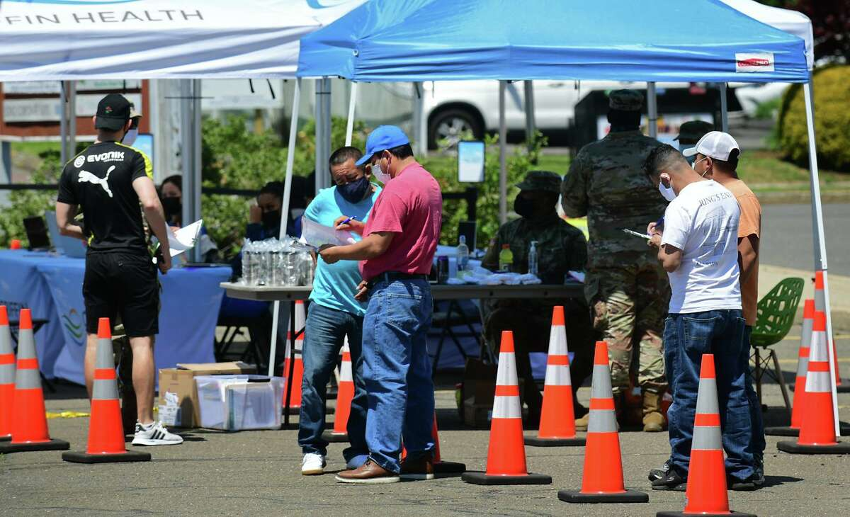The FEMA mobile vaccination clinic stationed in the parking lot at 50 Washington Street Friday, May 24, 2021, in Norwalk, Conn. The clinici is vaccinating people 12 and older and continues Saturday.