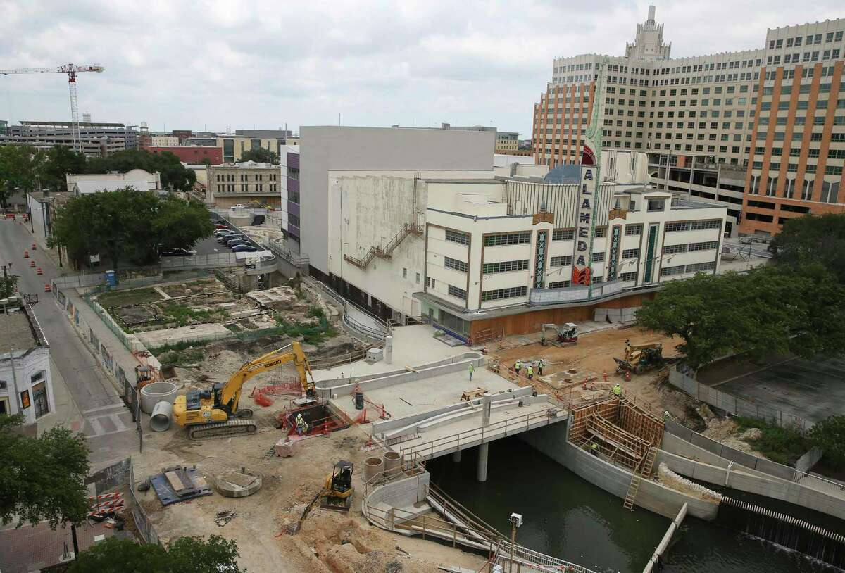Work is done on the Houston Street bridge over San Pedro Creek, Friday, May 14, 2021. The footprint of the 1870s historic African Methodist Episcopal Church is seen on the center left.