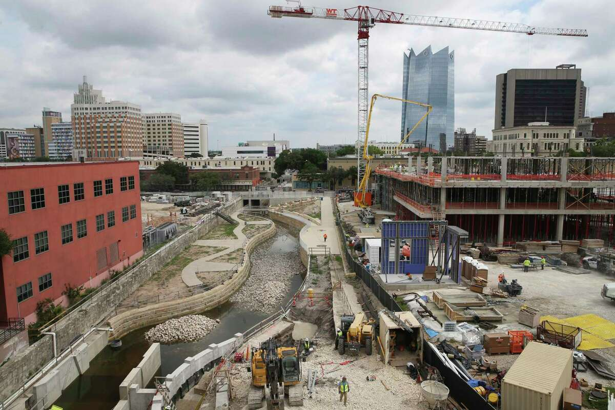 Work continues on the San Pedro Creek project, Friday, May 14, 2021. On the right, and under construction, is the UTSA School of Data Science and National Security Collaboration Center.