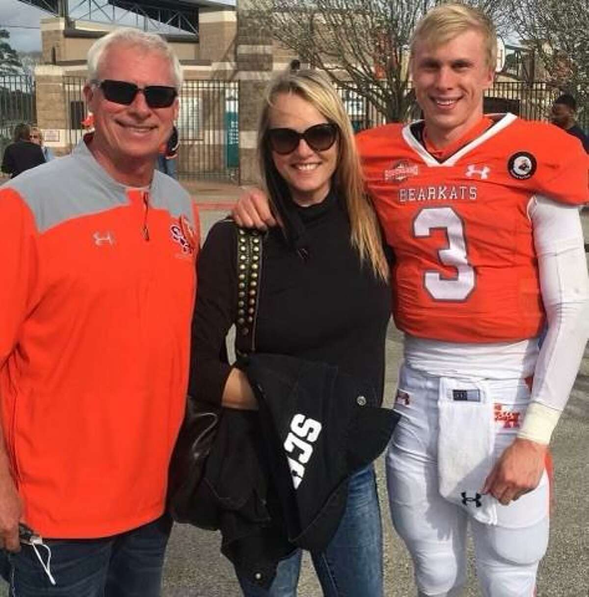Sam Houston quarterback Eric Scmid with his parents Mark and Sheryl Schmid..