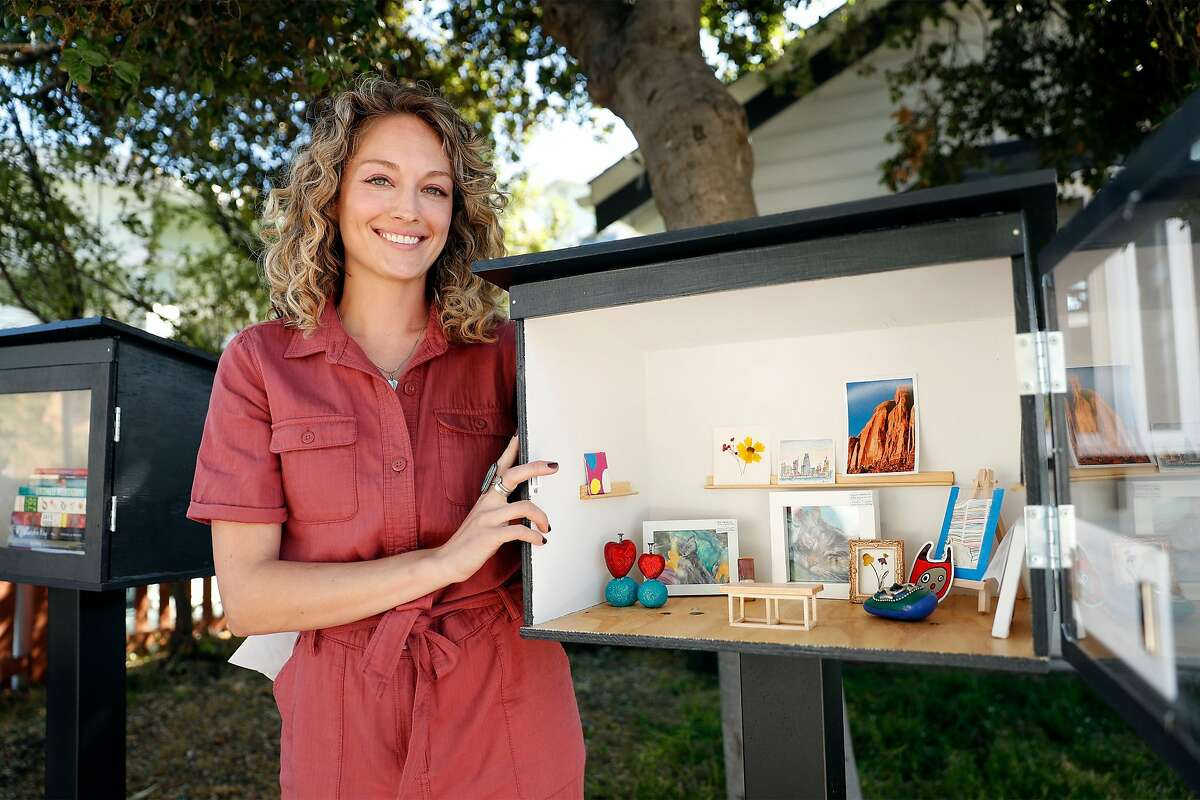 Allie St. Amand displays the little free gallery in front of her Oakland home. A bench for tiny art lovers is part of the setup.