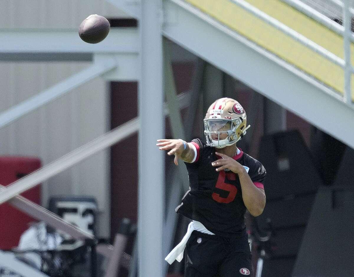 San Francisco 49ers rookie quarterback Trey Lance throws a pass during the NFL football rookie minicamp in Santa Clara, Calif., Friday, May 14, 2021. (AP Photo/Tony Avelar)