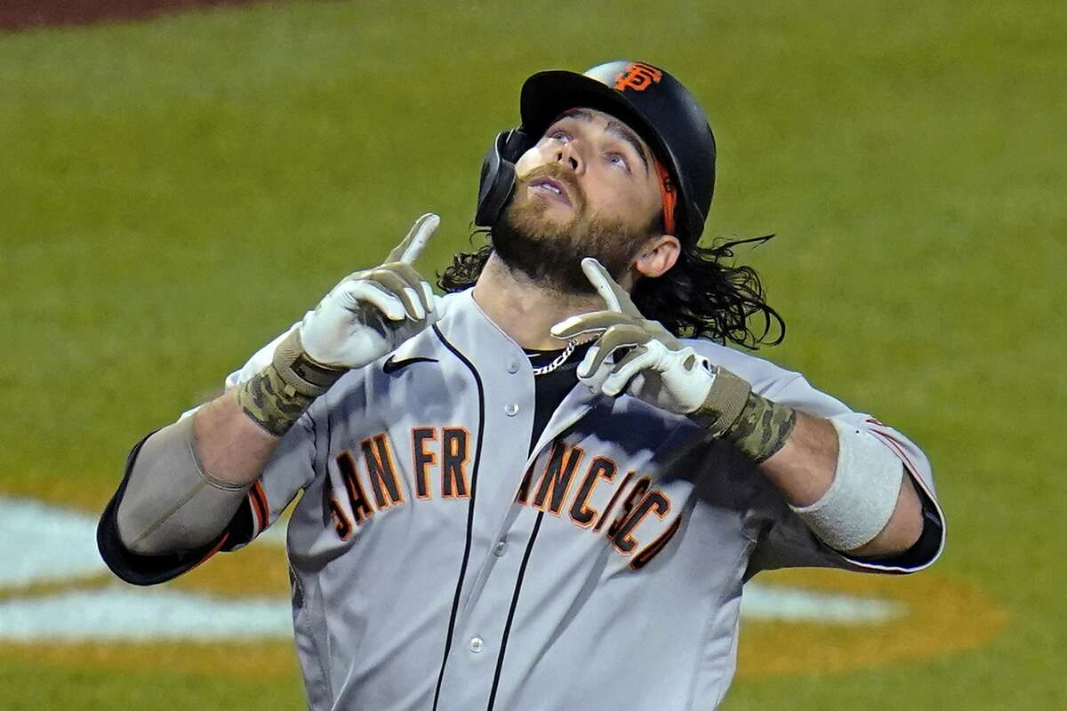San Francisco Giants' Brandon Crawford celebrates as he crosses home plate on a solo home run off Pittsburgh Pirates relief pitcher Duane Underwood Jr. during the eighth inning of a baseball game in Pittsburgh, Friday, May 14, 2021. (AP Photo/Gene J. Puskar)