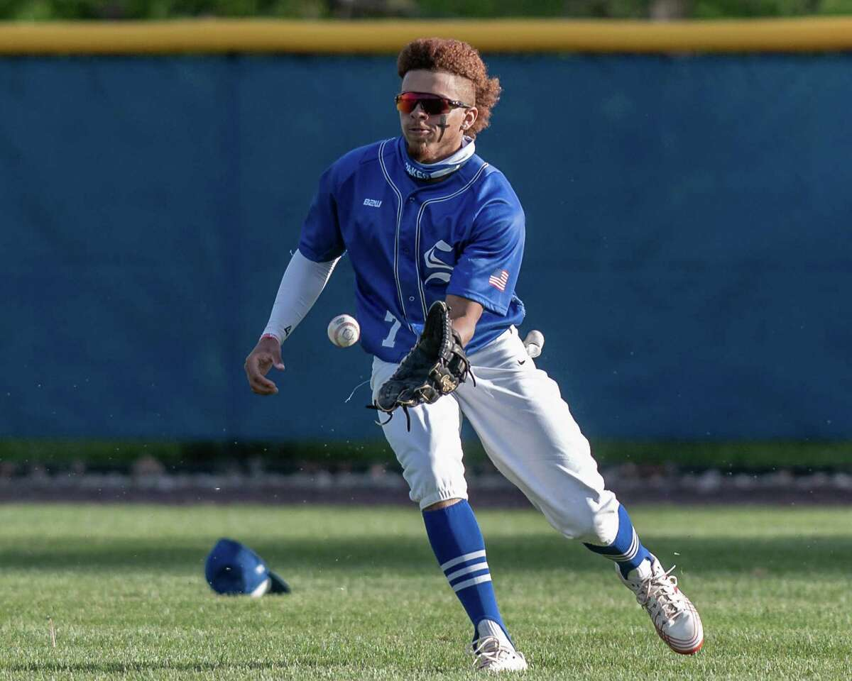 Shaker center fielder Jovani Wiggs fields a base hit during a Suburban Council matchup against Saratoga at Shaker High School in Latham, NY, on Friday, May 14, 2021. (Jim Franco/Special to the Times Union)
