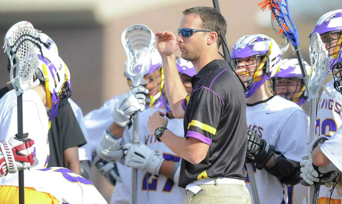 Westhill boys lacrosse coach Scott Stone talks with his team during a 2017 game in Stamford. Stone currently deployed overseas with the National Guard.