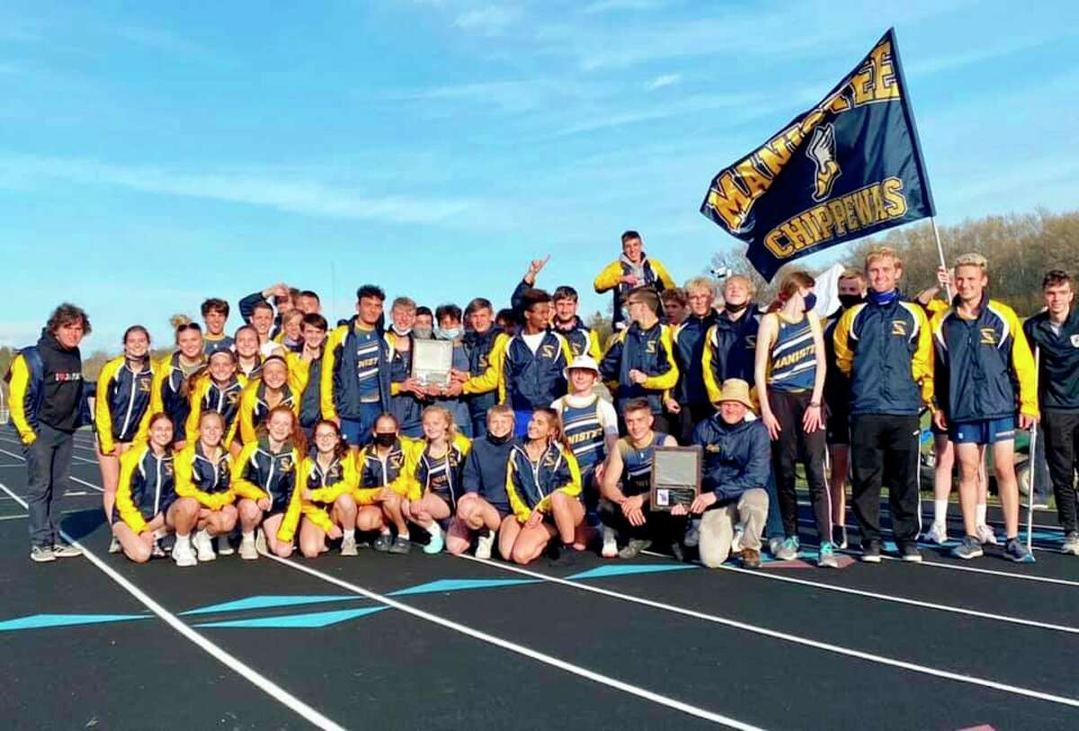 The Manistee track and field team poses with its Lakes 8 Conference championship on Friday after the boys and girls swept the championship meet. (Courtesy photo)