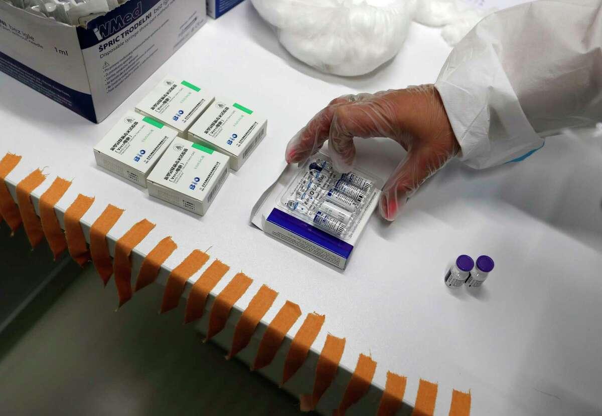 A medical worker prepares vials of COVID-19 vaccines in Belgrade, Serbia.