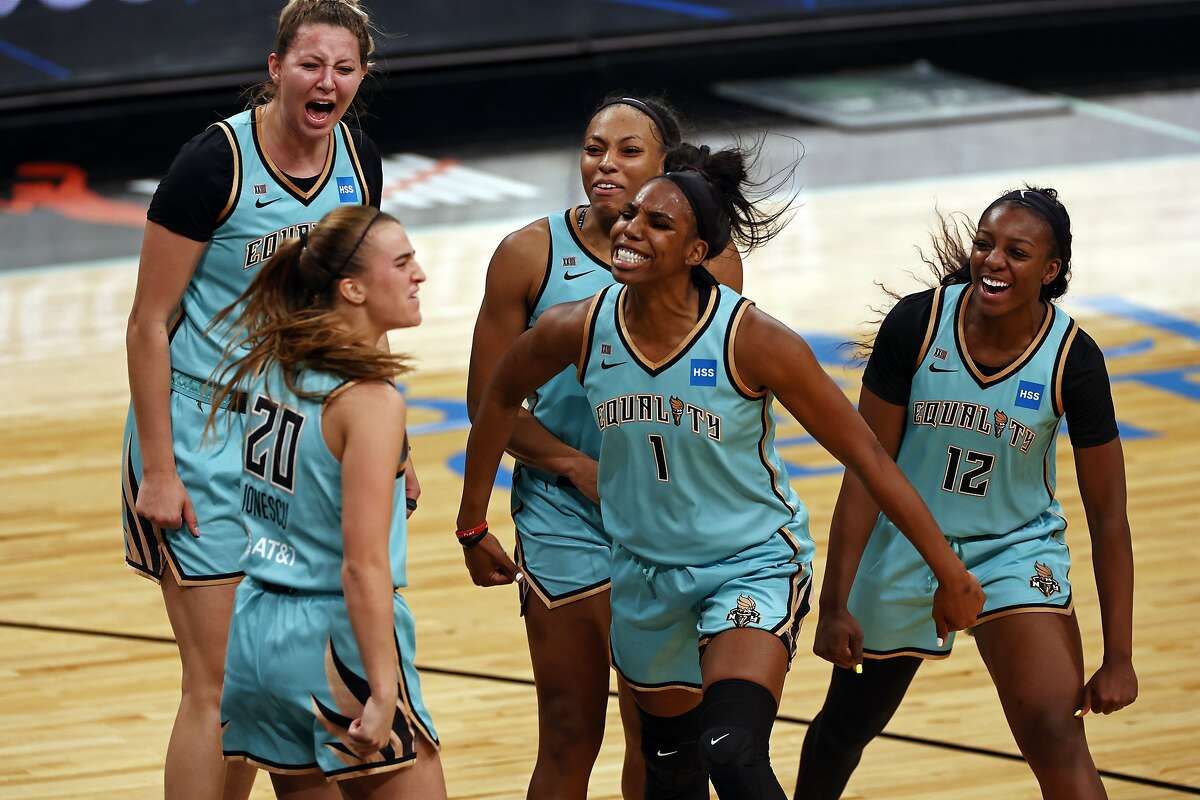 New York Liberty guard Sabrina Ionescu (20) is congratulated by teammates after making the game winning basket against the Indiana Fever during a WNBA basketball game, Friday, May 14, 2021, in New York. (AP Photo/Adam Hunger)