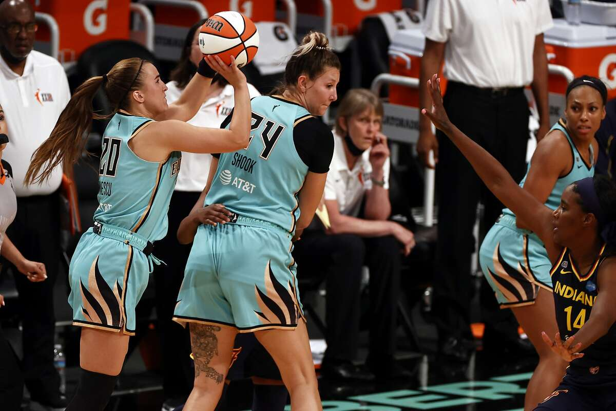 New York Liberty guard Sabrina Ionescu (20) shoots the game winning basket over Indiana Fever forward Jantel Lavender (14) during a WNBA basketball game, Friday, May 14, 2021, in New York. (AP Photo/Adam Hunger)