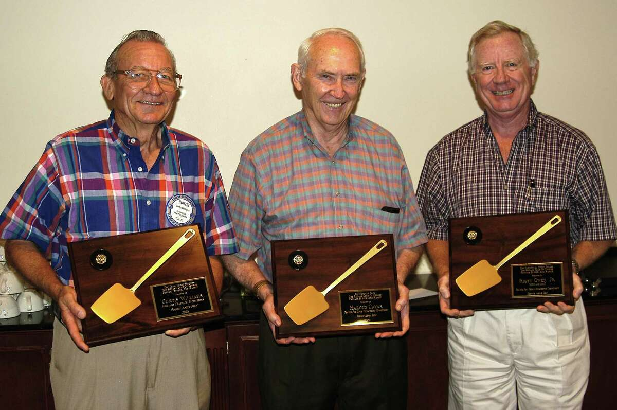 From left, Curtis Williams, Harold Cryar and Rigby Owen Jr. receive Golden Spatulas at the 2002 Rotary Club of Conroe Pancake Supper. The tradition returns Tuesday at 4:30 p.m.