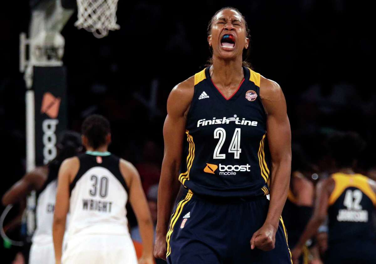 FILE - Indiana Fever forward Tamika Catchings (24) reacts against the New York Liberty during the second half in Game 3 of the WNBA basketball Eastern Conference finals at Madison Square Garden in New York, in this Tuesday, Sept. 29, 2015, file photo. Kobe Bryant was a major proponent of women's basketball, and his posthumous induction into the Basketball Hall of Fame this weekend will be alongside three legends of the women's game in Kim Mulkey, Tamika Catchings and Barbara Stevens. (AP Photo/Adam Hunger, File)