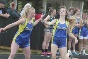 Morley Stanwood Aivery Devereaux (left) takes the handoff from Delaney McLaughlin during the 1600-meter relay of the CSAA Silver meet at MS on Friday. (Pioneer photo/John Raffel)