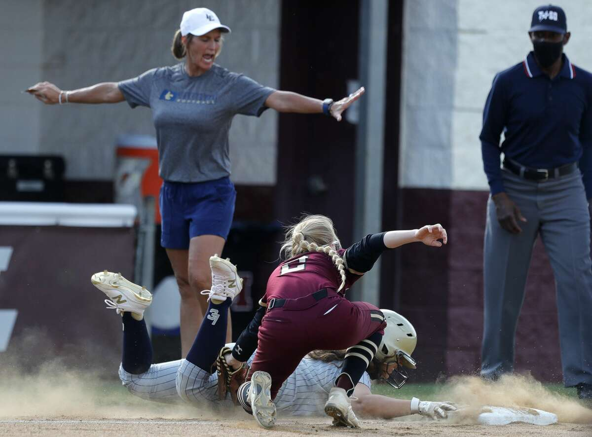 Madelyn Lopez #17 of Lake Creek beats the tag by Magnolia West third baseman Haleigh McDonald (5) during a one-game Region III-5A quarterfinal game at Magnolia High School, Friday, May 14, 2021, in Magnolia.
