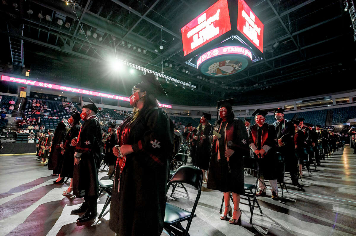 TAMIU graduates don their masks and sit socially distanced during the TAMIU Spring Commencement Ceremony, Friday, May 14, 2021, at the Sames Auto Arena.