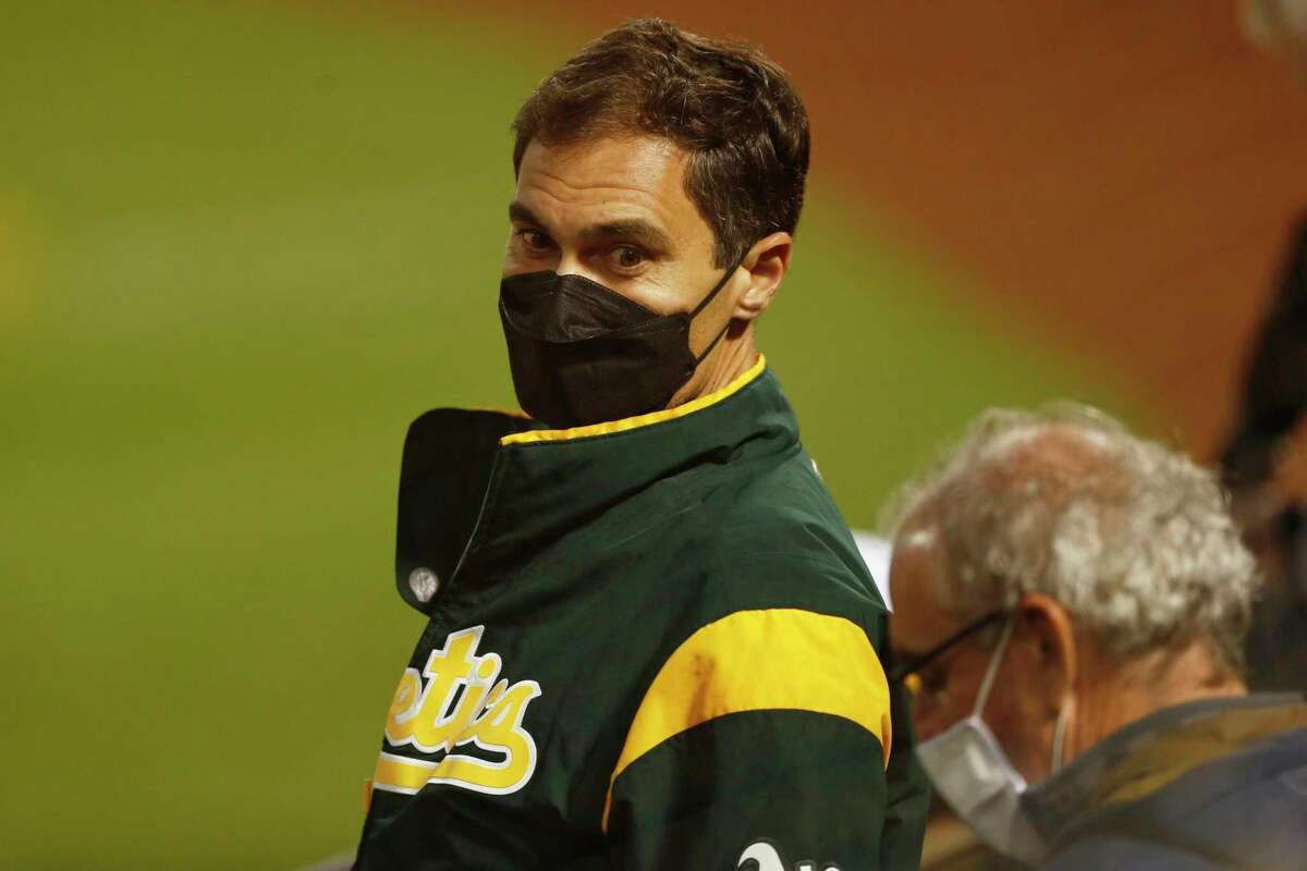 Oakland Athletics president Dave Kaval watches the lights that shut off and caused a game delay in the fifth inning during the second game of an MLB doubleheader at RingCentral Coliseum on Tuesday, April 20, 2021, in Oakland, Calif.