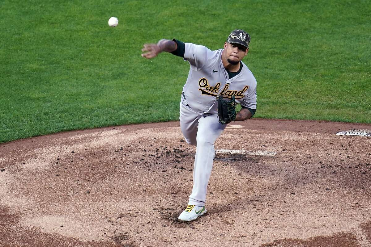 Oakland Athletics pitcher Frankie Montas (47) throws against the Minnesota Twins in the first inning of a baseball game, Friday, May 14, 2021, in Minneapolis. (AP Photo/Jim Mone)