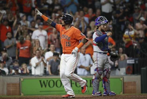 Houston Astros catcher Martin Maldonado (15) celebrates after hitting a two-run home run as Texas Rangers catcher Jose Trevino (23) waits nearby during the fifth inning of an MLB game Friday, May 14, 2021, at Minute Maid Park in Houston. Photo: Jon Shapley/Staff Photographer / © 2021 Houston Chronicle