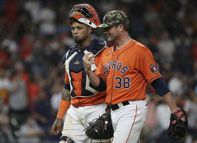 Houston Astros relief pitcher Joe Smith (38) talks with catcher Martin Maldonado (15) after the Houston Astros beat the Texas Rangers during an MLB game Friday, May 14, 2021, at Minute Maid Park in Houston. Photo: Jon Shapley/Staff Photographer / © 2021 Houston Chronicle