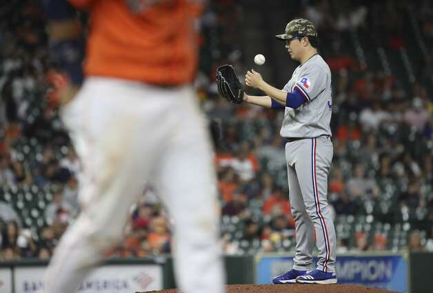 Texas Rangers relief pitcher Hyeon-Jong Yang (36) waits on the mound as Houston Astros first baseman Yuli Gurriel (10) walks during the sixth inning of an MLB game Friday, May 14, 2021, at Minute Maid Park in Houston. Photo: Jon Shapley/Staff Photographer / © 2021 Houston Chronicle