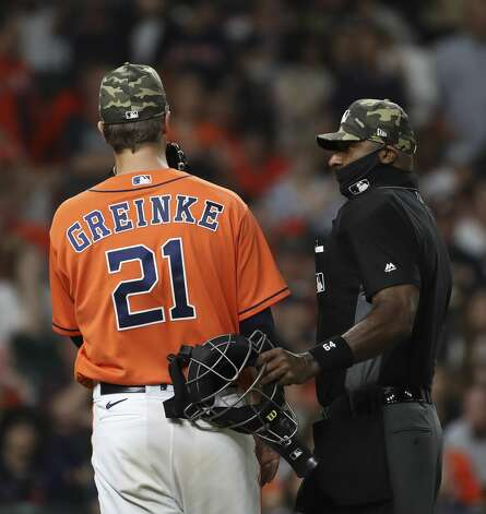 Houston Astros starting pitcher Zack Greinke (21) talks with home plate umpire Alan Porter during the seventh inning of an MLB game Friday, May 14, 2021, at Minute Maid Park in Houston. Photo: Jon Shapley/Staff Photographer / © 2021 Houston Chronicle