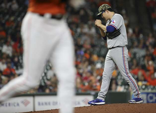 Texas Rangers relief pitcher Hyeon-Jong Yang (36) waits on the mound as as Houston Astros shortstop Carlos Correa (1) walks during the sixth inning of an MLB game Friday, May 14, 2021, at Minute Maid Park in Houston. Photo: Jon Shapley/Staff Photographer / © 2021 Houston Chronicle