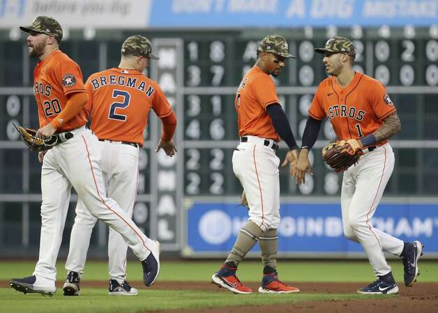 Houston Astros right fielder Chas McCormick (20), third baseman Alex Bregman (2), second baseman Robel Garcia (9) and shortstop Carlos Correa (1) celebrate after the Houston Astros beat the Texas Rangers during an MLB game Friday, May 14, 2021, at Minute Maid Park in Houston. Photo: Jon Shapley/Staff Photographer / © 2021 Houston Chronicle