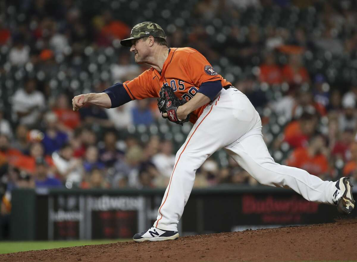 Houston Astros relief pitcher Joe Smith (38) pitches during the ninth inning of an MLB game Friday, May 14, 2021, at Minute Maid Park in Houston.