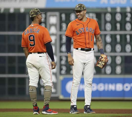 Houston Astros shortstop Carlos Correa (1) and second baseman Robel Garcia (9) laugh after the Houston Astros beat the Texas Rangers during an MLB game Friday, May 14, 2021, at Minute Maid Park in Houston. Photo: Jon Shapley/Staff Photographer / © 2021 Houston Chronicle