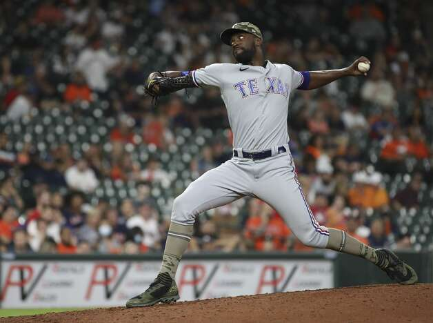 Texas Rangers relief pitcher Taylor Hearn (52) pitches during the seventh inning of an MLB game Friday, May 14, 2021, at Minute Maid Park in Houston. Photo: Jon Shapley/Staff Photographer / © 2021 Houston Chronicle