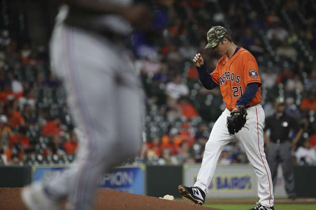 Houston Astros starting pitcher Zack Greinke (21) walks back to the mound as Texas Rangers center fielder Adolis Garcia (53) walks during the fourth inning of an MLB game Friday, May 14, 2021, at Minute Maid Park in Houston. Photo: Jon Shapley/Staff Photographer / © 2021 Houston Chronicle