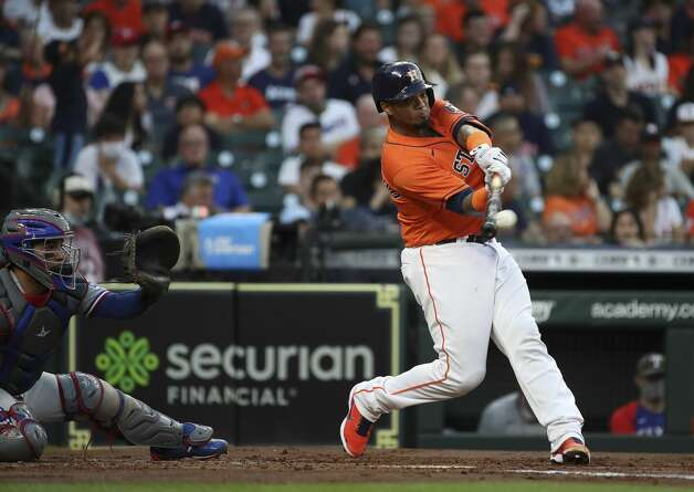 Houston Astros catcher Martin Maldonado (15) hits a single during the second inning of an MLB game Friday, May 14, 2021, at Minute Maid Park in Houston. Photo: Jon Shapley/Staff Photographer / © 2021 Houston Chronicle