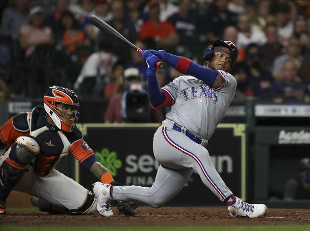 Texas Rangers left fielder Willie Calhoun (5) strikes out on a pitch from Houston Astros starting pitcher Zack Greinke (21) during the fifth inning of an MLB game Friday, May 14, 2021, at Minute Maid Park in Houston. Photo: Jon Shapley/Staff Photographer / © 2021 Houston Chronicle