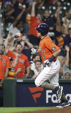 Fans cheer as Houston Astros center fielder Myles Straw (3) rounds third on a home run by catcher Martin Maldonado (15) during the fifth inning of an MLB game Friday, May 14, 2021, at Minute Maid Park in Houston. Photo: Jon Shapley/Staff Photographer / © 2021 Houston Chronicle