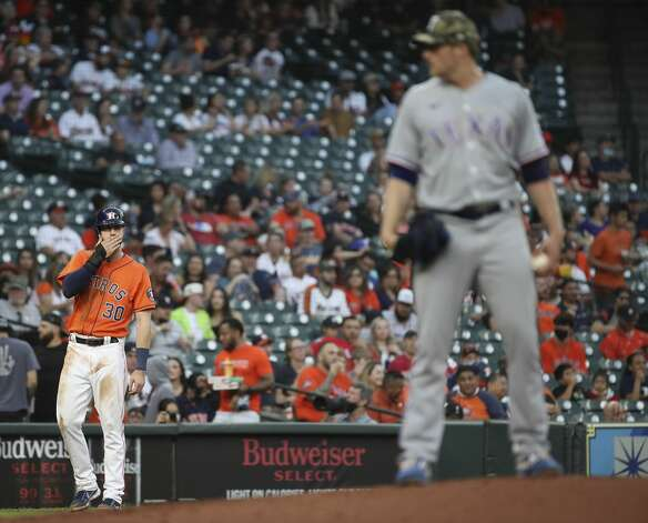 Houston Astros right fielder Kyle Tucker (30) watches Texas Rangers starting pitcher Wes Benjamin (63) as he pitches during the second inning of an MLB game Friday, May 14, 2021, at Minute Maid Park in Houston. Photo: Jon Shapley/Staff Photographer / © 2021 Houston Chronicle