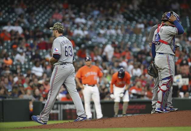 Texas Rangers starting pitcher Wes Benjamin (63) is removed during the second inning of an MLB game Friday, May 14, 2021, at Minute Maid Park in Houston. Photo: Jon Shapley/Staff Photographer / © 2021 Houston Chronicle