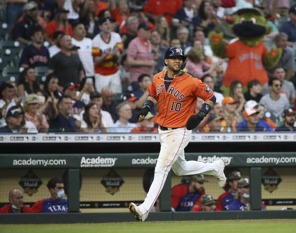 Houston Astros first baseman Yuli Gurriel (10) scores on a single by right fielder Kyle Tucker (30) during the second inning of an MLB game Friday, May 14, 2021, at Minute Maid Park in Houston. Photo: Jon Shapley/Staff Photographer / © 2021 Houston Chronicle