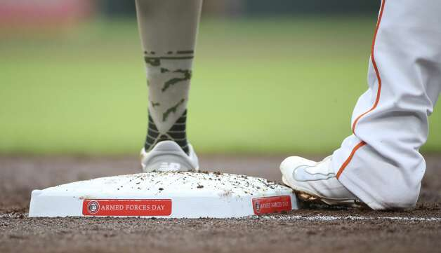 Houston Astros first baseman Yuli Gurriel (10) stands with his foot on first base during the second inning of an MLB game Friday, May 14, 2021, at Minute Maid Park in Houston. Photo: Jon Shapley/Staff Photographer / © 2021 Houston Chronicle