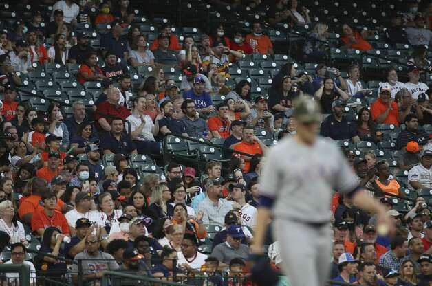 Fans watch as Texas Rangers starting pitcher Wes Benjamin (63) walks back to the mound after a third Houston Astros run scores during the second inning of an MLB game Friday, May 14, 2021, at Minute Maid Park in Houston. Photo: Jon Shapley/Staff Photographer / © 2021 Houston Chronicle