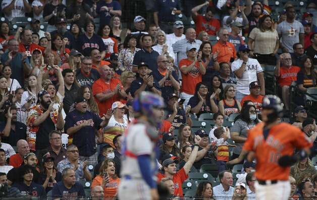 Fans cheer as Houston Astros first baseman Yuli Gurriel (10) scores on a single by right fielder Kyle Tucker (30) during the second inning of an MLB game Friday, May 14, 2021, at Minute Maid Park in Houston. Photo: Jon Shapley/Staff Photographer / © 2021 Houston Chronicle