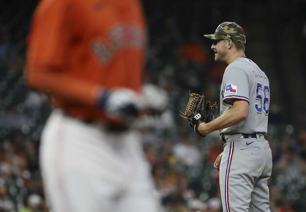 Texas Rangers relief pitcher Brett de Geus (56) waits on the mound as Houston Astros center fielder Myles Straw (3) walks to first, bringing in a run during the third inning of an MLB game Friday, May 14, 2021, at Minute Maid Park in Houston. Photo: Jon Shapley/Staff Photographer / © 2021 Houston Chronicle