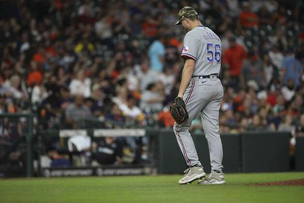 Texas Rangers relief pitcher Brett de Geus (56) walks to the dugout after being removed during the third inning of an MLB game Friday, May 14, 2021, at Minute Maid Park in Houston. Photo: Jon Shapley/Staff Photographer / © 2021 Houston Chronicle